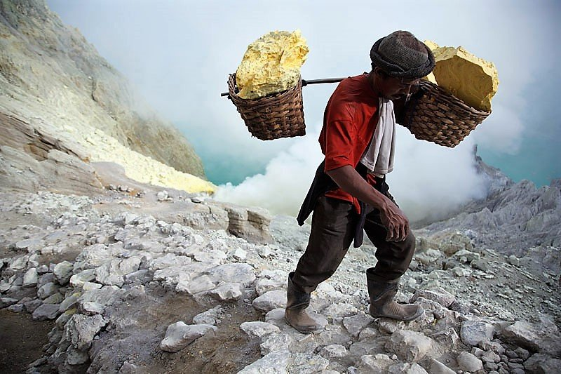 Sulfur collecting in the crater of Ijen Volcano, Java