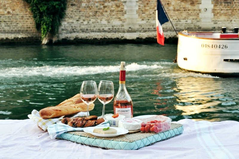 Picnic on the banks of river Seine.