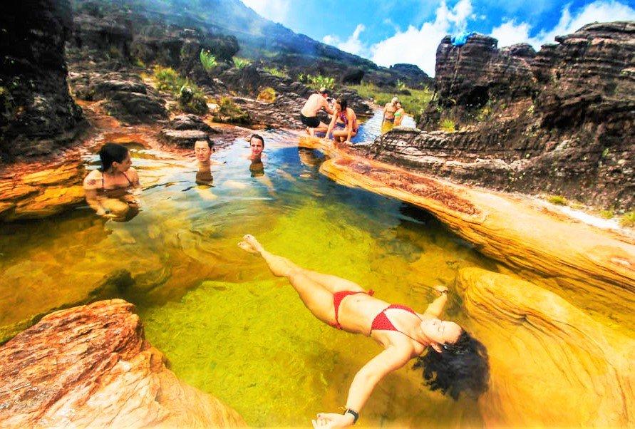 On the peak of the plateau there are natural pools with the bottom covered with rock crystal, Caracas