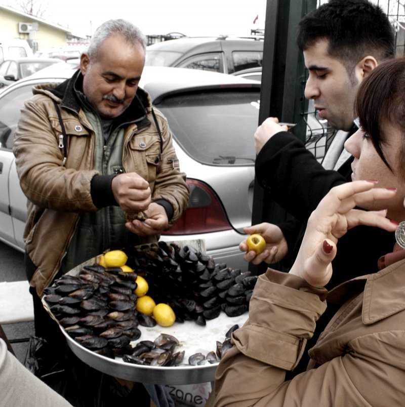 The seller of mussels in the street