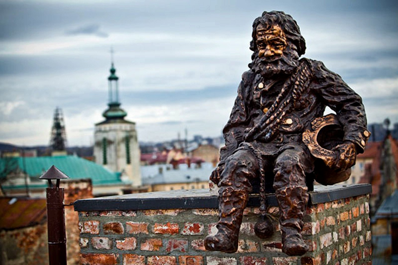 How to make a wish at the pipe chimney monument in Lviv