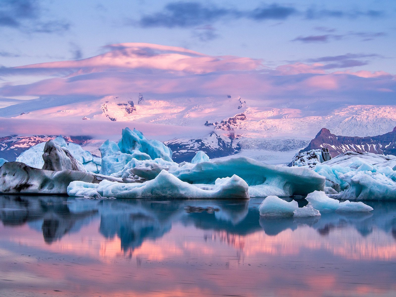 How to see a sunset over floating icebergs in Reykjavik