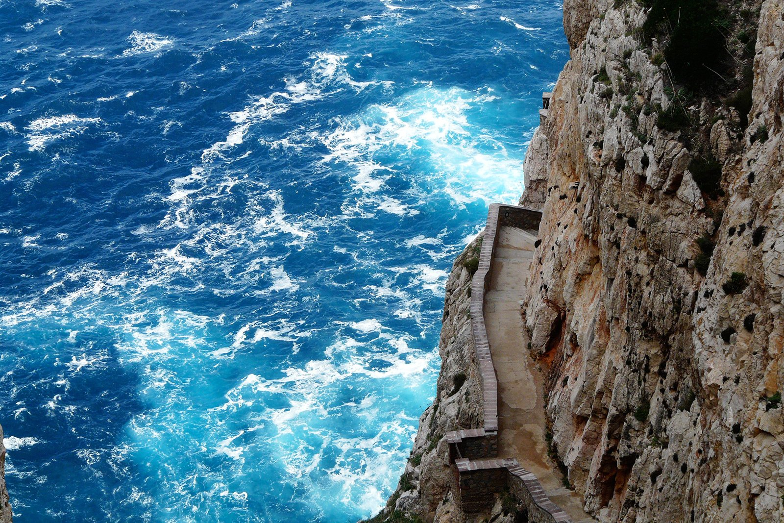 How to walk the breakneck stairs Scala del Capriolo on Sardinia