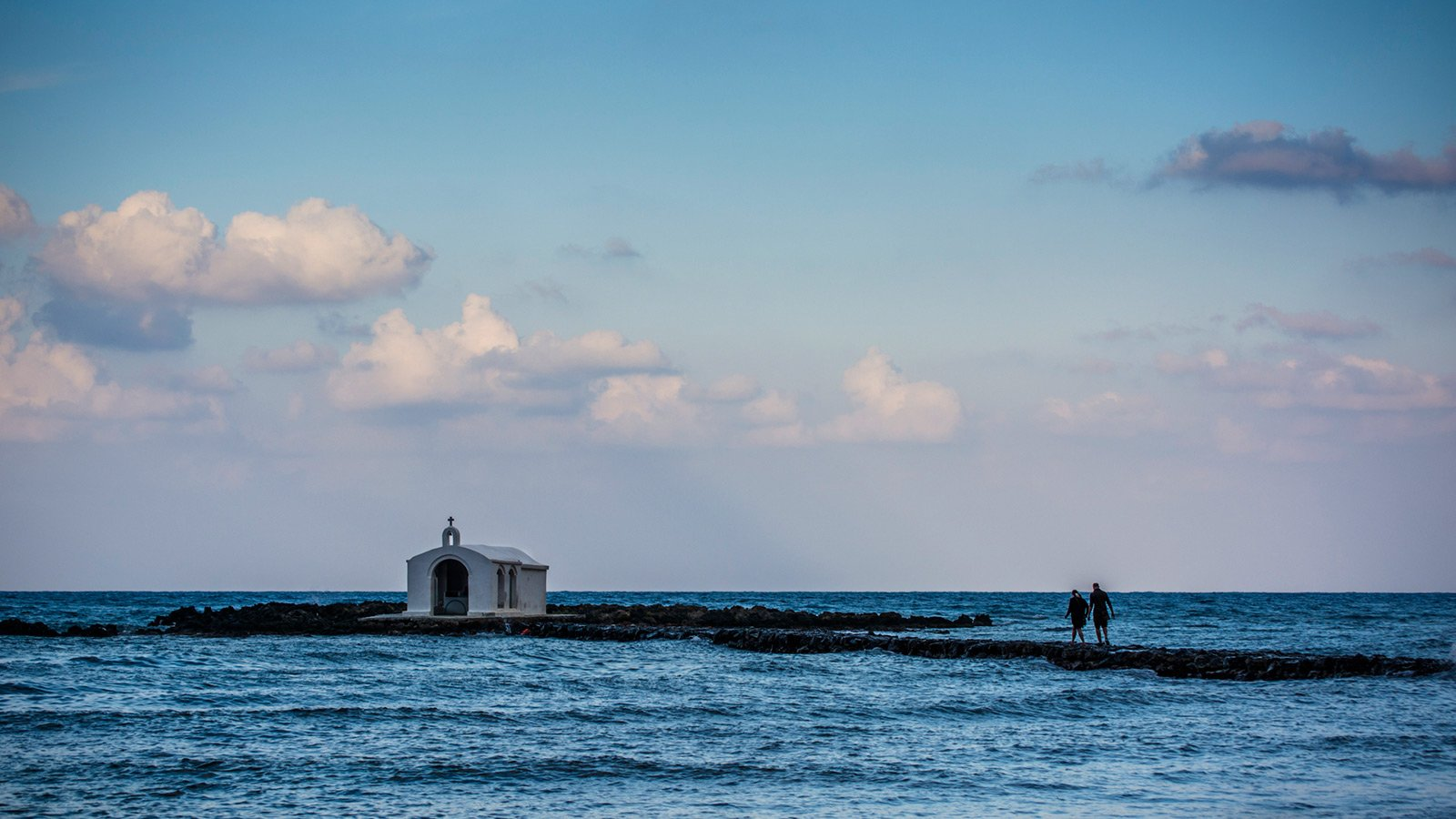 How to take a walk on the spit to the church of St. Nicholas on Crete