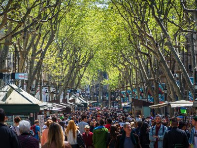 Take a walk through La Rambla in Barcelona