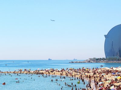 Take a sun tan on the Barceloneta Beach in Barcelona