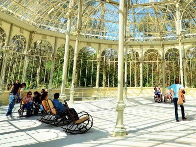 Sit in a rocking-chair in the Crystal Palace in Madrid