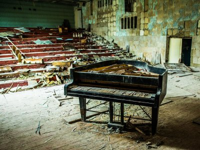 Play the abandoned piano in Chernobyl