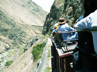 Take a ride through the Andes on a train top in Alausi