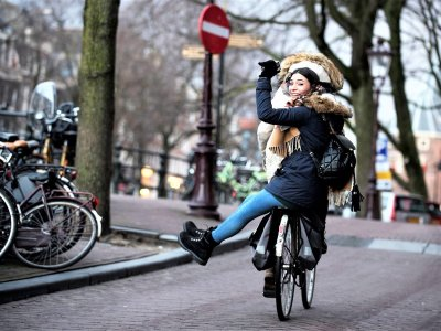 Ride a bike around the city in Amsterdam