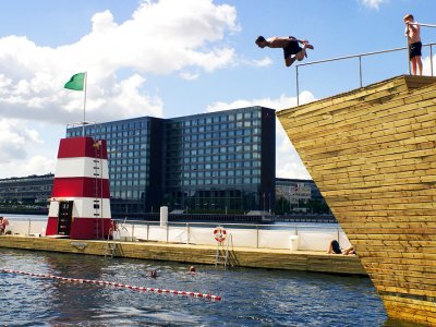 Jump into outdoor pool in Copenhagen