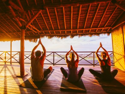 Do yoga at dawn in Bali