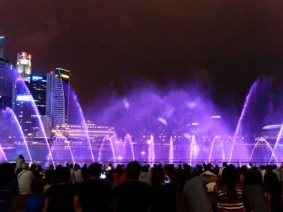 Watch fountain light show in Singapore