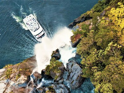 Go under a fjord waterfall on a ship board in Queenstown