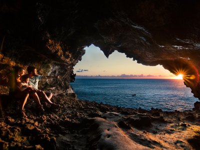 Watch the sunset from the cave on Easter Island
