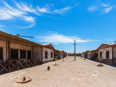 Wander around a ghost town's streets in Iquique
