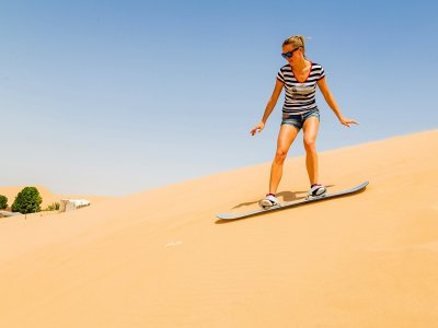 Try sandboarding on sand dunes in Dubai