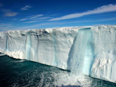 See glacial waterfalls in Svalbard