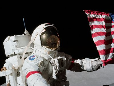 Take a selfie with American flag as a background on the Moon