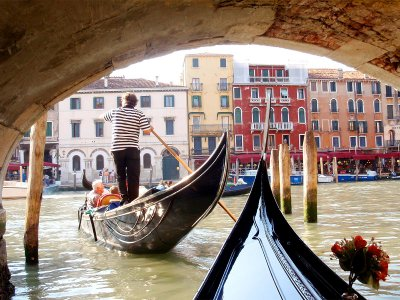Take a gondola ride through Venice canals in Venice