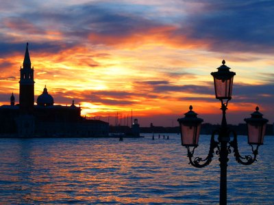 See a sunset on the waterfront in Venice