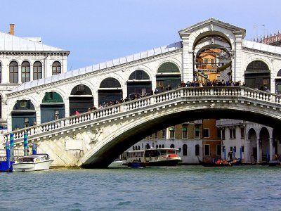 Take a walk through the Rialto Bridge in Venice