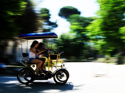 Explore Villa Borghese in the quadricycle in Rome