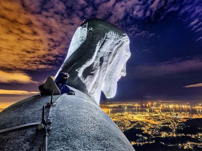 Climb to the top of the statue of Christ the Redeemer in Rio de Janeiro