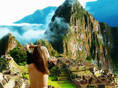 Take a naked selfie on the background of Machu Picchu in Aguas Calientes