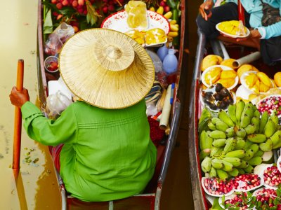 Visit a floating market in Bangkok