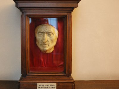 See the death mask of Dante in Florence