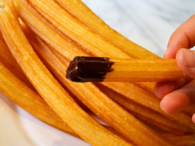 Try churros in Madrid