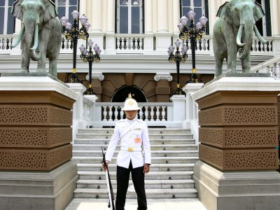 Take a selfie with a guard at the Grand Palace in Bangkok