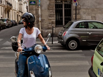 Ride on retro scooter in Paris