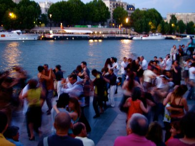Dance tango on the bank of the Seine in Paris