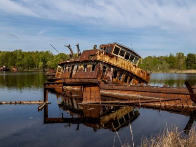 Cemetery of barges and abandoned ships in Chernobyl