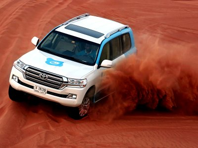 Evening Red-Dunes Desert Safari Dubai: Dune bashing-BBQ-Falcon & Sandboarding